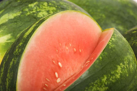 Bright red and green watermelon with a slice removed Stok Fotoğraf