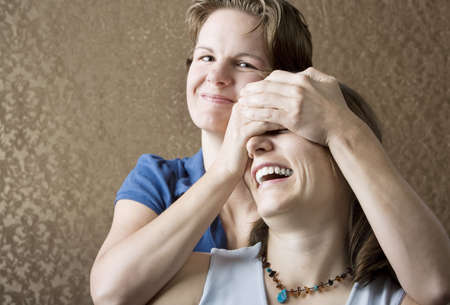 Portrait of Two Pretty Young Women Friends Playing and Laughing photo