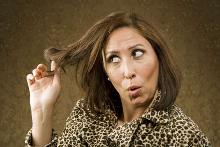 primp: Hispanic Woman in Leopard Print Coat with Big Hair Stock Photo