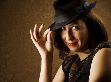 tipping: Pretty Hispanic Woman Tipping Her Fedora Hat