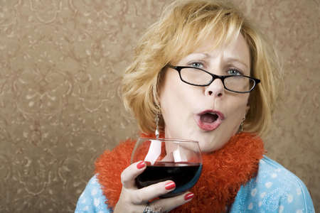 brassy: Extroverted woman with a funny expression drinking red wine