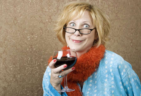 garish: Woman with a big grin drinking red wine