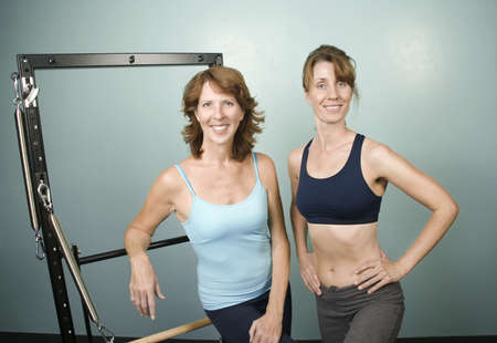 ed: Portrait of Two Pretty Personal Trainers in a Gym Stock Photo