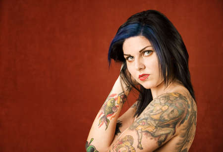 cute tattoo: Pretty young woman with many colorful tattoos Stock Photo