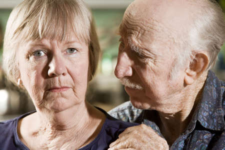 Close Up Portrait of Worried Senior Couple photo