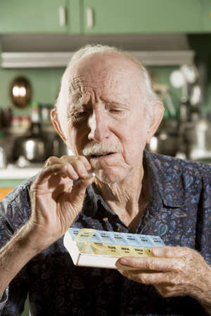 dementia: Portrait of Elder Man Discussing Medications Stock Photo