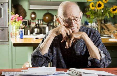 preoccupied: Elder Man at Home with Bills