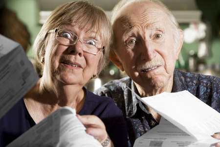 preoccupied: Elder Couple at Home with Bills