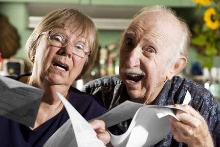 perplex: Elder Couple at Home with Bills