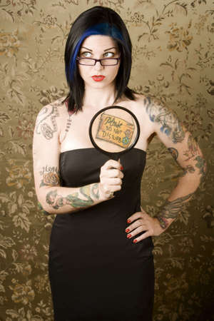 shy: Pretty young woman with many tattoos Stock Photo