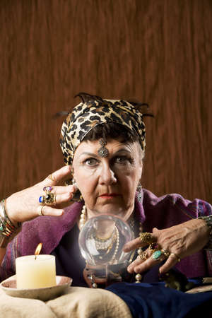 clairvoyant: Female gypsy fortune teller with a crystal ball