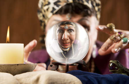 Female gypsy fortune teller looking into a crystal ball Stock Photo - 3536343