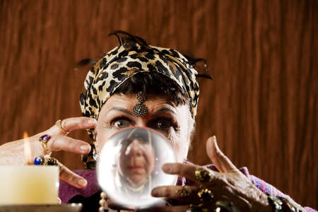 newage: Female gypsy fortune teller looking into a crystal ball