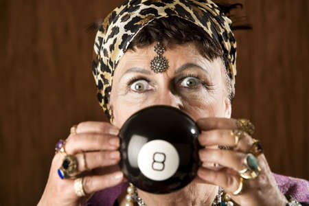 Gypsy looking at an eight ball to predict the future Stock Photo - 3536350