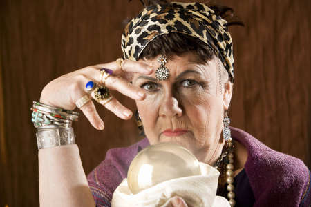 Female gypsy fortune teller with a crystal ball Stock Photo - 3536358