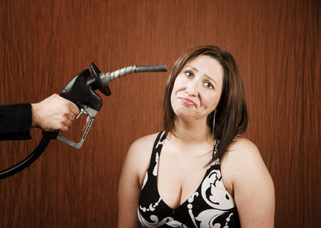 stickup: Woman with a gas nozzle pointed like a gun to her head