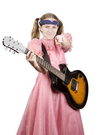 dweeb: Young girl in a pink dress with an electric rock guitar pointing