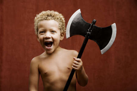 Young shirtless boy with a toy hatchet Stock Photo