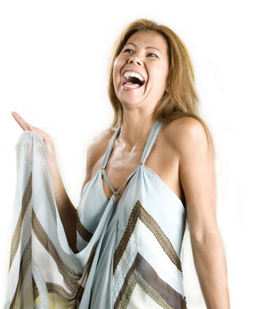 Pretty ethnic woman laughing on a white background