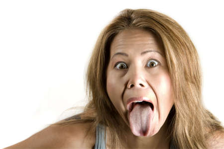 Pretty ethnic woman sticking out her tongue
