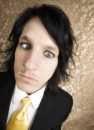 Wide Angle Closeup of Rock and Roll Businessman with Crossed Eyes photo