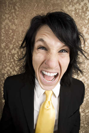 bawl: Screaming young man in a business suit and tie