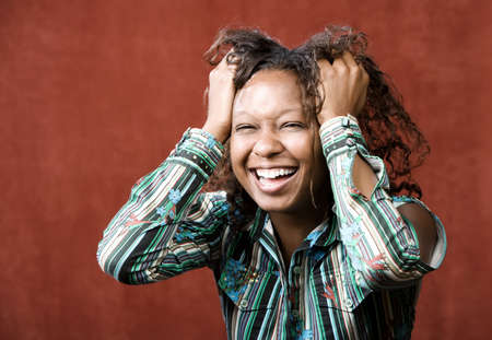 hilarity: Close-Up Portrait of an Laughing African-American Woman