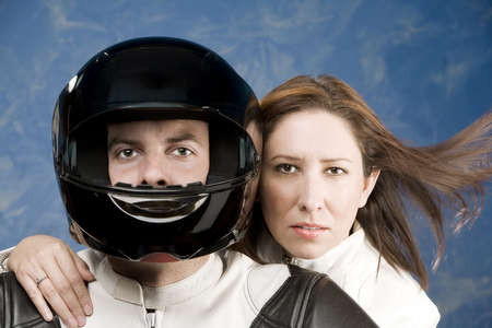 ady: Man and woman on a motorcycle in studio