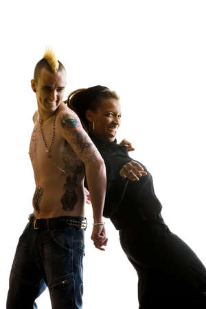 Man with Mohawk and Woman wearing Dreadlocks Stock Photo