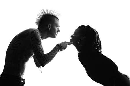 spat: Man with Mohawk and Woman wearing Dreadlocks Stock Photo