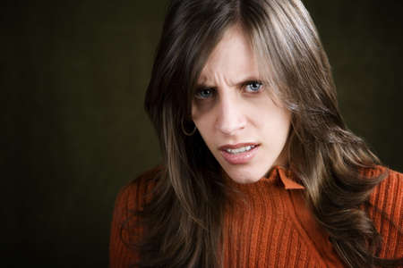 distraught: Distraught Young Woman in an Orange Sweater