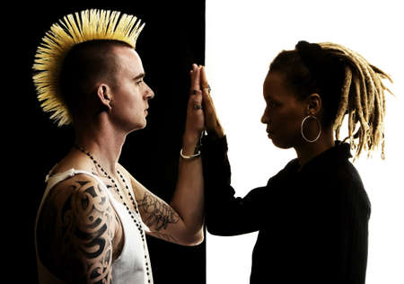 Caucasian Man with Mohawk and African-American Woman with Dreadlocks photo