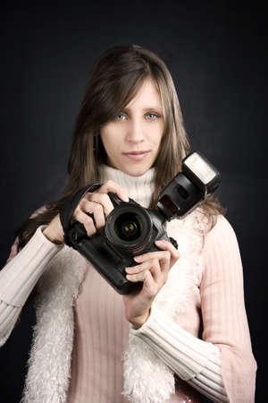 プロのカメラとフラッシュかなりカメラマン 写真素材
