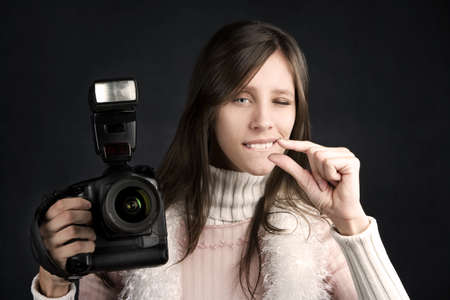 Pretty photographer with a professional camera and flash 스톡 콘텐츠