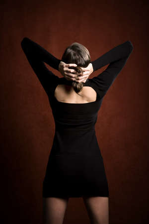 stretchy: Pretty Woman in a Stretchy Knit Black Dress from Behind