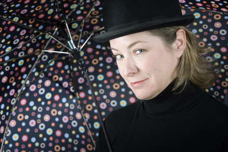 Woman in bowler hat with spotted umbrella Zdjęcie Seryjne