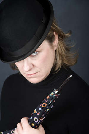 Woman in bowler hat with spotted umbrella Stock Photo - 4021376
