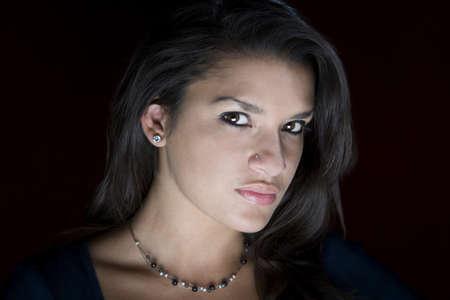 Pretty young Hispanic woman in a studio photo