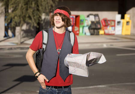 Handsome Young Male Tourist with Crumpled Map Фото со стока