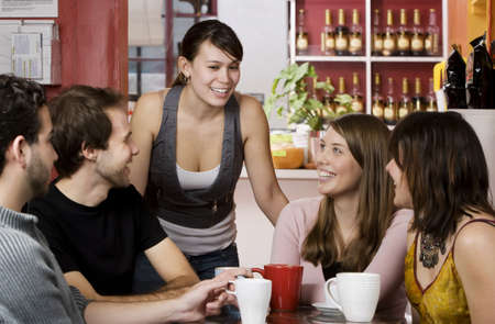 Five young friends in a coffee house photo
