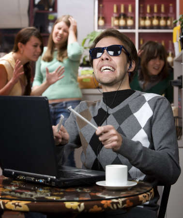obnoxious: Obnoxious young man singing loudly in a coffee house Stock Photo
