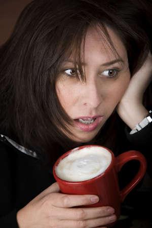 cradling: Half awake woman cradling a mug of coffee