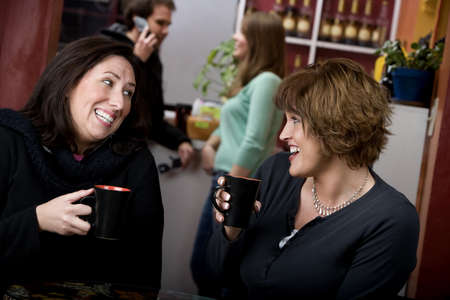 Two pretty adult women in a coffee house photo