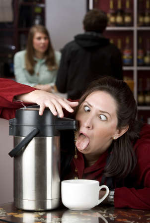 coffee table: Woman drinking coffee directly from a beverage dispenser