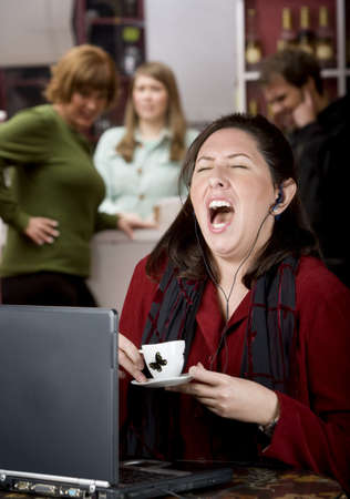 obnoxious: Obnoxious young woman singing loudly in a coffee house