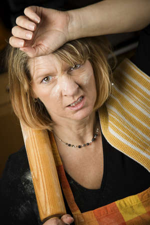 Frustrated Woman Baker with Rolling Pin Covered in Flour