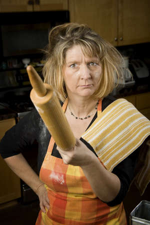 Frustrated Woman Baker with Rolling Pin Covered in Flour Stock Photo - 4237561