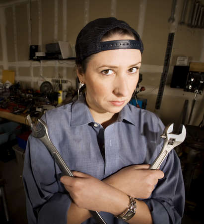Hispanic woman in a garage with wrenches photo