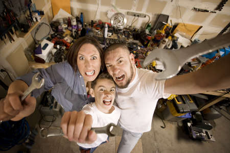 crescent wrench: Crazy Hispanic family in garage with crescent wrenches