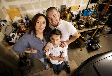 doityourself: Do-it-yourself family in their garage. Stock Photo
